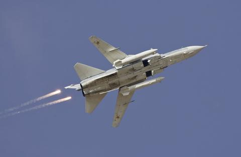 A Sukhoi Su-24 jet fighter drops flares during a joint Kazakh-Russian military exercise at Otar military range, west of Almaty, in this October 3, 2008 file picture. A warplane shot down by Turkey near the Syrian border on November 24, 2015 was a Russian-made SU-24, Turkish presidential sources said, adding it was downed in line with Turkey's rules of engagement after violating Ankara's airspace. Russia's defence ministry said the downed fighter jet was Russian and did not violate Turkish airspace, the RIA news agency reported. REUTERS/Shamil Zhumatov/Files