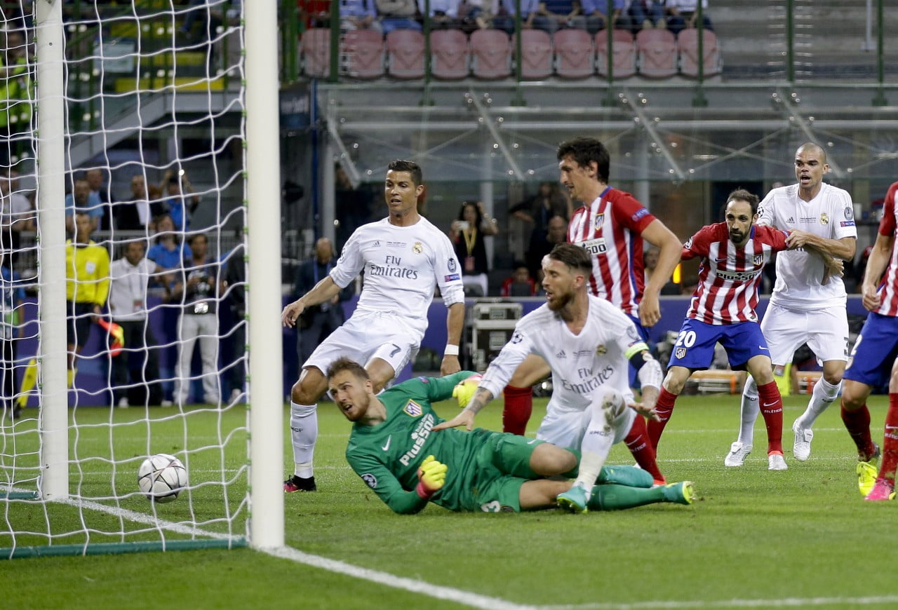 Real Madrid's Sergio Ramos, center, scores his side's first goal during the Champions League final soccer match between Real Madrid and Atletico Madrid